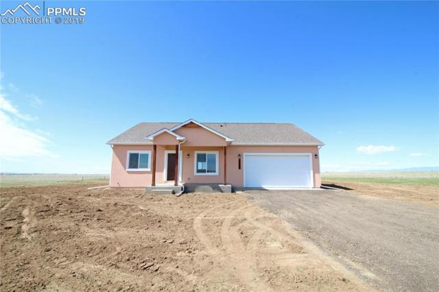 30007 Lonesome Dove Lane, Calhan, CO 80808 (#9949588) :: The Peak Properties Group