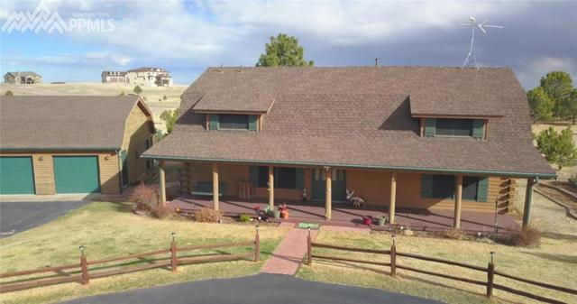 11855 Broken Antler Court, Peyton, CO 80831 (#1145533) :: The Treasure Davis Team