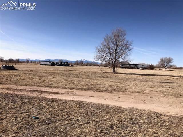 5740 Coyote Lane, Peyton, CO 80831 (#3466565) :: 8z Real Estate