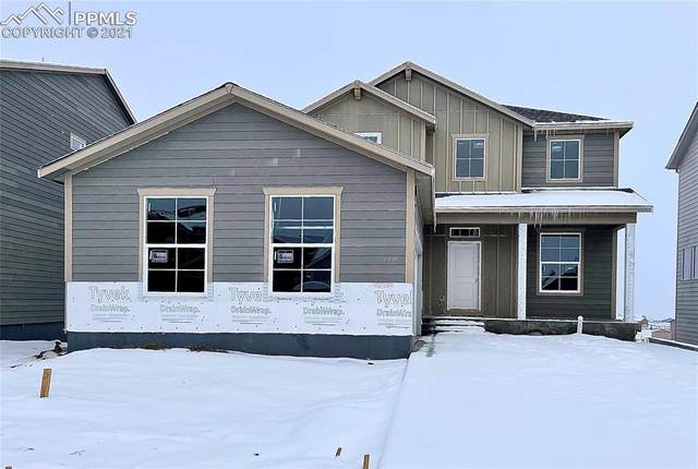 9711 Vistas Park Drive, Peyton, CO 80831 (#4386299) :: The Treasure Davis Team