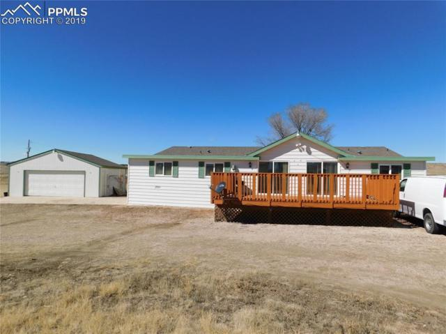 11556 Highway 94 Highway, Colorado Springs, CO 80929 (#4785794) :: The Treasure Davis Team