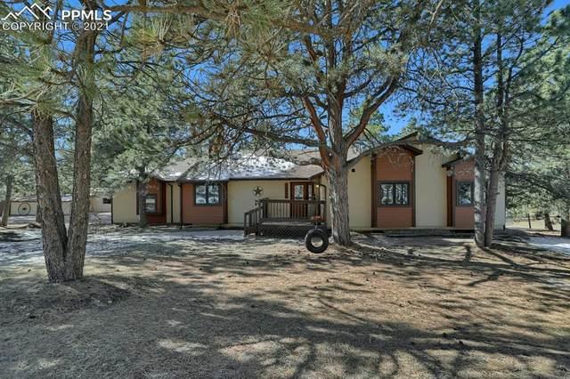 14990 E Coachman Drive, Colorado Springs, CO 80908 (#8055397) :: The Kibler Group