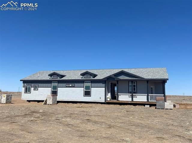 22230 Farmer Road, Colorado Springs, CO 80928 (#9135458) :: Action Team Realty