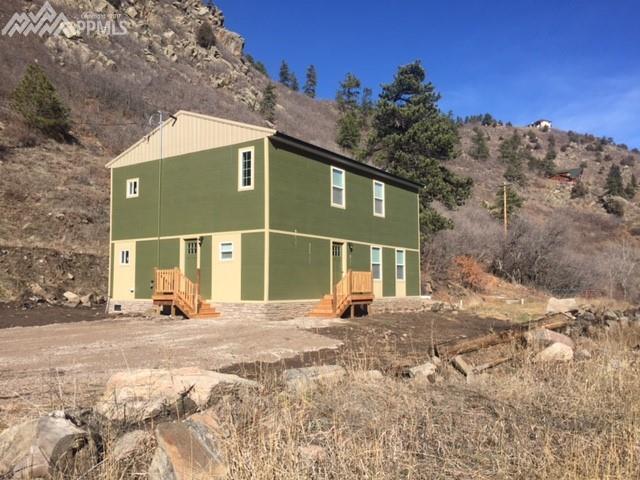 16403 W Deer Creek Canyon Road, Littleton, CO 80127 (#1094577) :: The Hunstiger Team