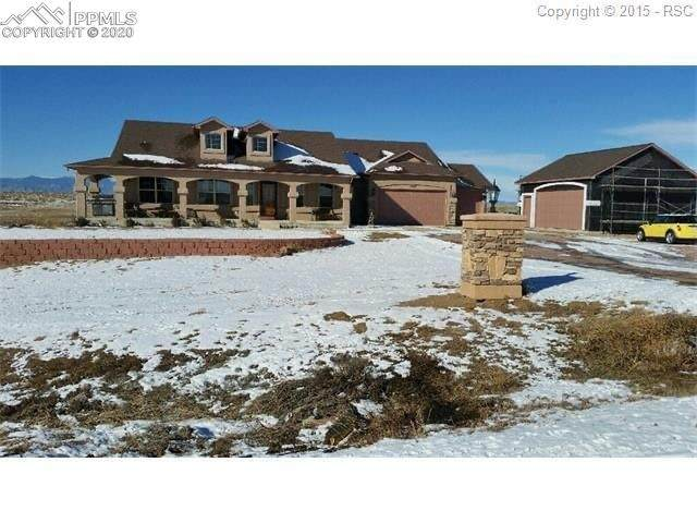 1910 Swigert Way, Colorado Springs, CO 80929 (#1204285) :: Tommy Daly Home Team