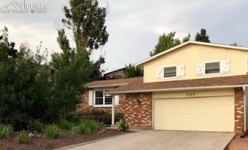 5523 Wilkerson Pass Drive, Colorado Springs, CO 80917 (#1291644) :: Tommy Daly Home Team