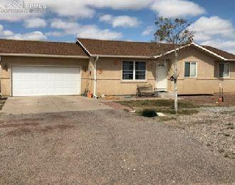 61 E Lyons Drive, Pueblo West, CO 81007 (#1979263) :: The Hunstiger Team