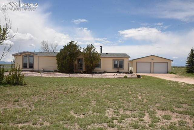 6870 Sphinx Court, Peyton, CO 80831 (#3018135) :: The Kibler Group