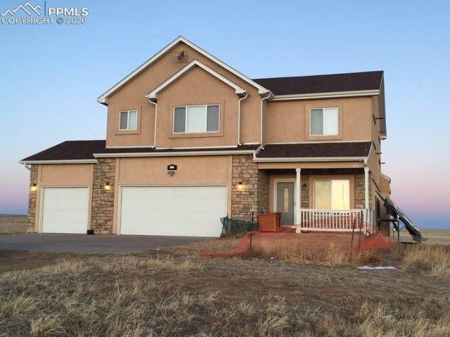 2883 Mahers Landing Point, Calhan, CO 80808 (#3910778) :: The Treasure Davis Team