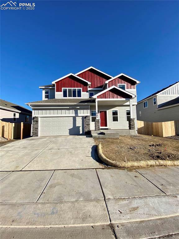 6593 Lamine Drive, Colorado Springs, CO 80925 (#4100978) :: 8z Real Estate