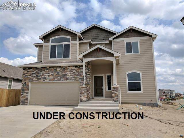 9843 Fairway Glen Drive, Peyton, CO 80831 (#4124914) :: The Kibler Group