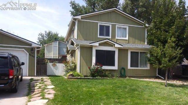2040 Sarsi Drive, Colorado Springs, CO 80915 (#4360592) :: Tommy Daly Home Team