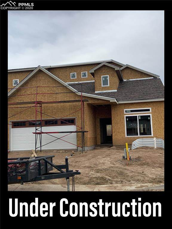 5452 Silverstone Terrace, Colorado Springs, CO 80919 (#4734166) :: Tommy Daly Home Team