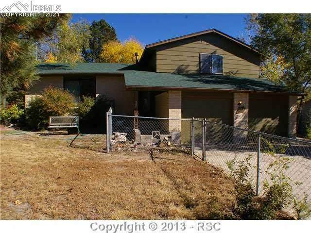 6615 Palmer Park Boulevard, Colorado Springs, CO 80915 (#4827753) :: Symbio Denver