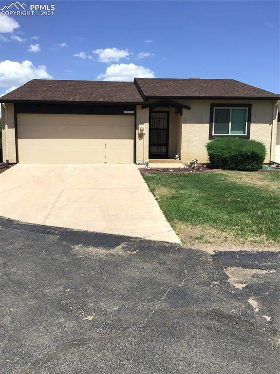 5075 Elm Grove Drive, Colorado Springs, CO 80911 (#4857909) :: Tommy Daly Home Team