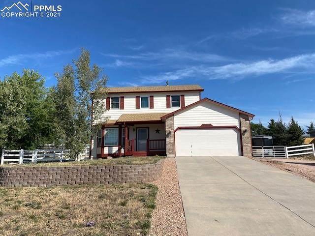 11641 Cranston Drive, Peyton, CO 80831 (#5283622) :: The Kibler Group