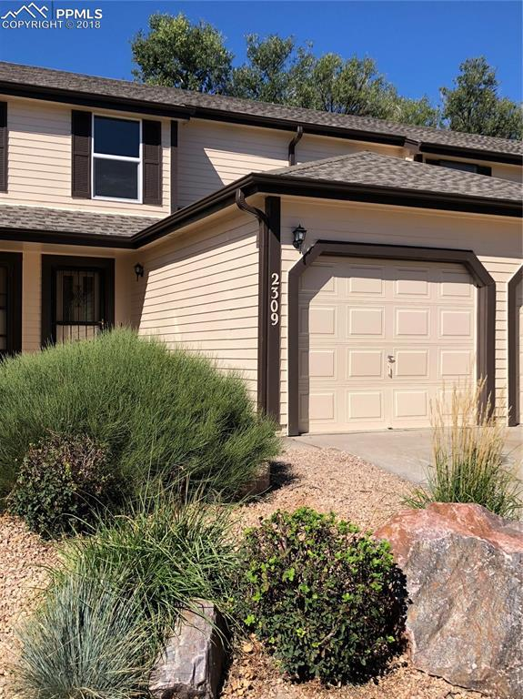 2309 Lexington Village Lane, Colorado Springs, CO 80916 (#8928330) :: The Hunstiger Team