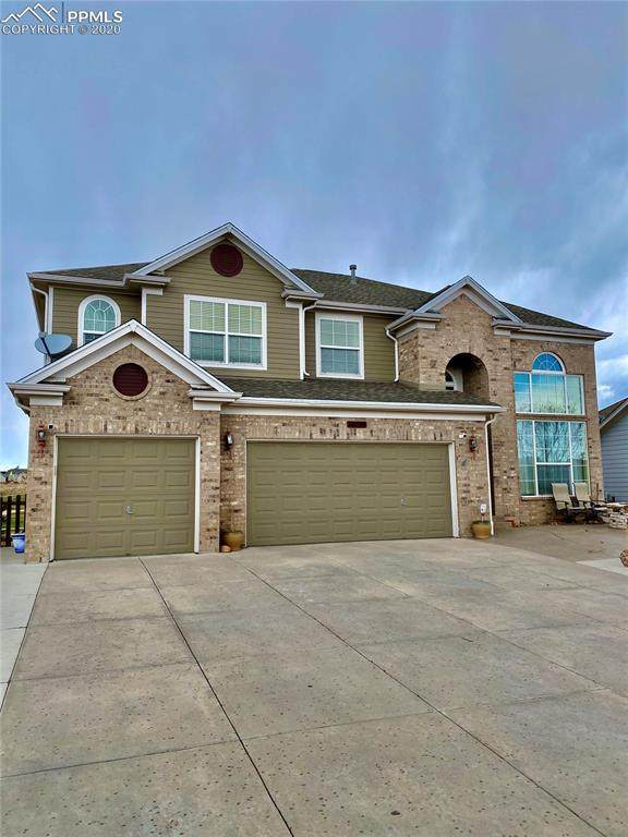12154 Pine Valley Circle, Peyton, CO 80831 (#3300116) :: The Kibler Group