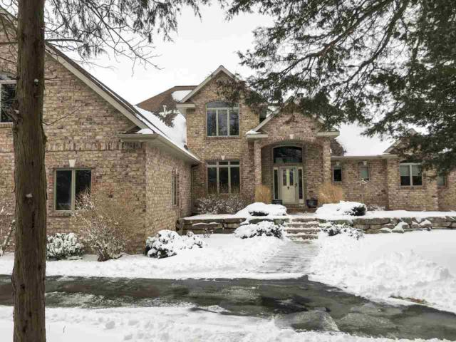 4401 Gibson Lane, Green Bay, WI 54311 (#50179130) :: Todd Wiese Homeselling System, Inc.