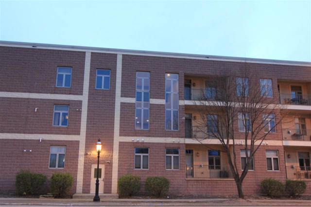 555 Main Avenue #213, De Pere, WI 54115 (#50194646) :: Todd Wiese Homeselling System, Inc.
