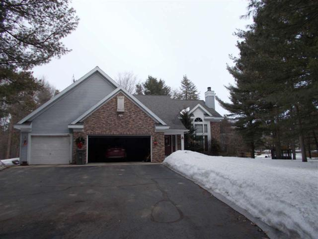 W1468 Autumn Wood Lane, Marinette, WI 54143 (#50199976) :: Todd Wiese Homeselling System, Inc.
