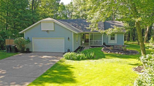E2307 Woodridge Drive, Waupaca, WI 54981 (#50205665) :: Todd Wiese Homeselling System, Inc.