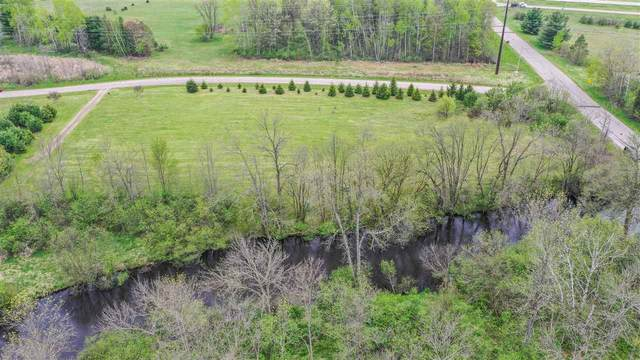E1518 River Wood Drive, Waupaca, WI 54981 (#50223331) :: Todd Wiese Homeselling System, Inc.