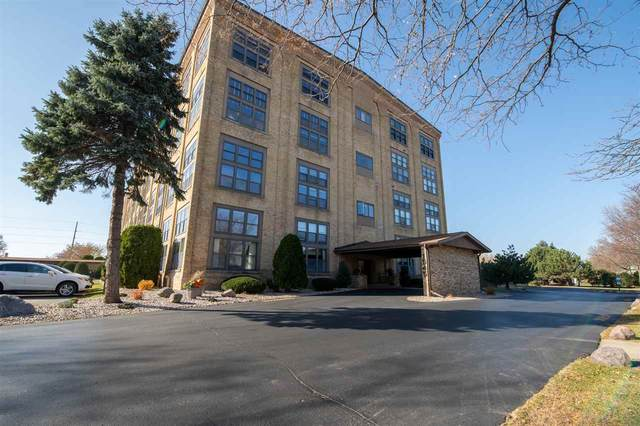 1545 Arboretum Drive #407, Oshkosh, WI 54901 (#50234472) :: Todd Wiese Homeselling System, Inc.