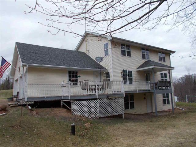 W14180 Oakwood Hills Drive, Silver Cliff, WI 54104 (#50198665) :: Todd Wiese Homeselling System, Inc.