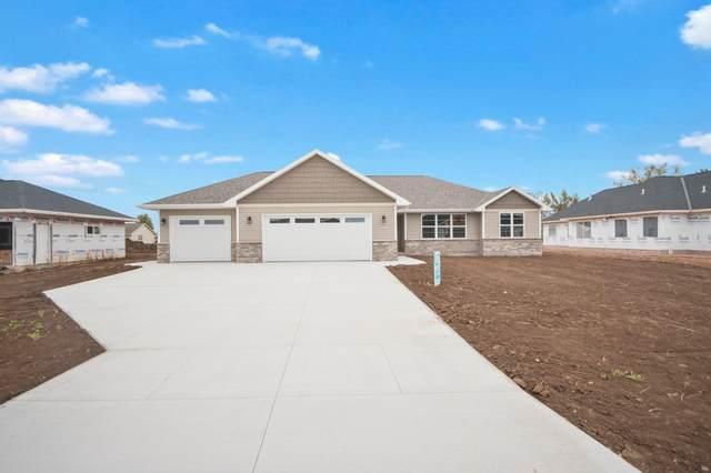 750 Covered Wagon Trail, Pulaski, WI 54162 (#50246624) :: Ben Bartolazzi Real Estate Inc