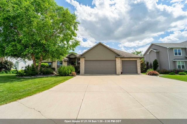 1352 Whispering Pines Lane, Neenah, WI 54956 (#50206719) :: Todd Wiese Homeselling System, Inc.