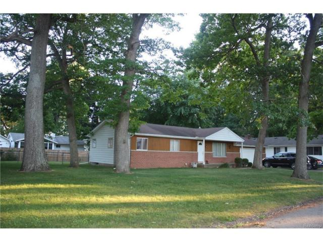633 Chicago Dr, Howell, MI 48843 (MLS #217053735) :: The John Wentworth Group