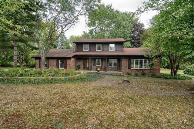 2802 Independence Ln, Hartland, MI 48353 (MLS #217086025) :: The John Wentworth Group