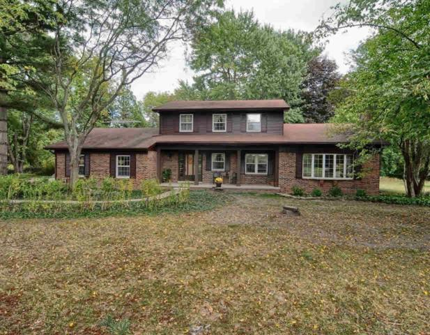 2802 Independence Ln, Hartland, MI 48353 (MLS #30070234) :: The John Wentworth Group