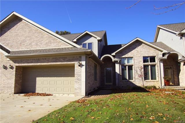 644 Olde Ivy Ln #18, Howell, MI 48843 (MLS #217102669) :: The John Wentworth Group