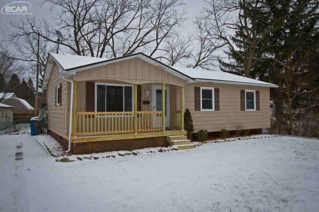 1112 Marion Dr, Holly, MI 48442 (MLS #30071534) :: The John Wentworth Group