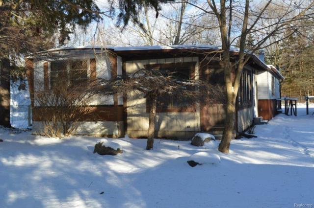 521 Cherokee Bend Dr, Howell, MI 48843 (MLS #217109327) :: The John Wentworth Group
