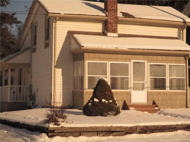 310 Oakland St, Holly, MI 48442 (MLS #218001188) :: The John Wentworth Group