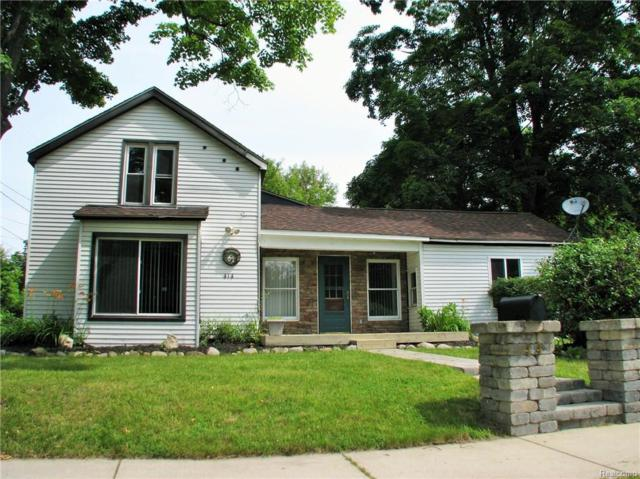 414 Oakland St, Holly, MI 48442 (MLS #218001566) :: The John Wentworth Group