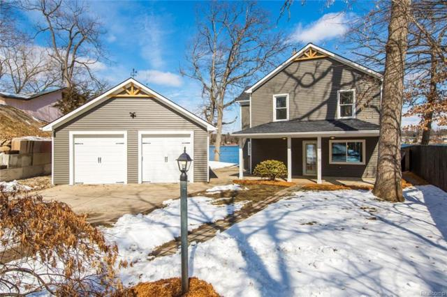 6517 Knox Dr, Brighton, MI 48116 (MLS #218021512) :: The John Wentworth Group