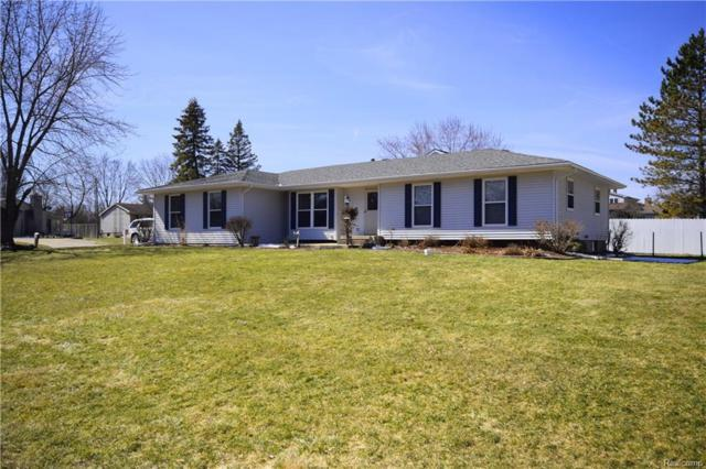 8328 Belle Bluff Dr, Grand Blanc, MI 48439 (MLS #218022732) :: The John Wentworth Group