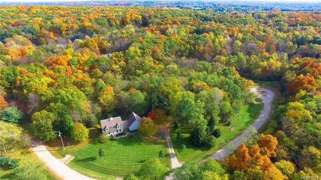 Havenwood Trl, Howell, MI 48843 (MLS #218022942) :: The John Wentworth Group