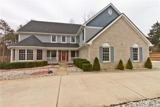5425 Walnut Hills Dr, Brighton, MI 48116 (MLS #218023670) :: The John Wentworth Group