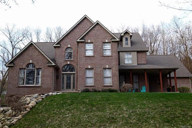 9340 Grand Summit Dr, Fenton, MI 48430 (MLS #218038699) :: The John Wentworth Group