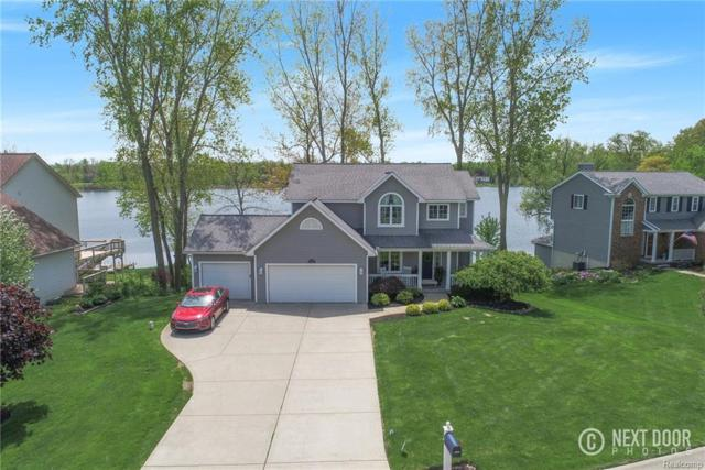 1433 Eden Gardens Dr, Fenton, MI 48430 (MLS #218044771) :: The John Wentworth Group
