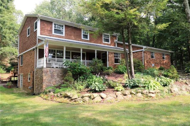 5391 Mountain Rd, Brighton, MI 48116 (MLS #218078833) :: The John Wentworth Group