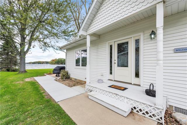 5727 Long Pointe Dr, Howell, MI 48843 (MLS #218101169) :: The John Wentworth Group
