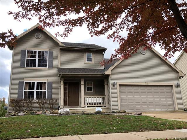 3868 Sugarbush Dr, Howell, MI 48843 (MLS #218103013) :: The John Wentworth Group