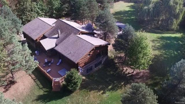 4340 Lahring Rd, Holly, MI 48442 (MLS #218105387) :: The John Wentworth Group