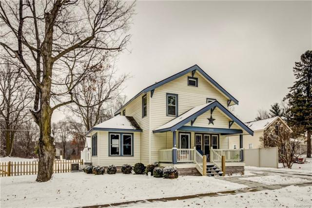 10501 Maple Rd, Hartland, MI 48353 (MLS #219011213) :: The John Wentworth Group